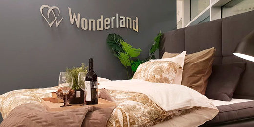 Wonderland bed with logo